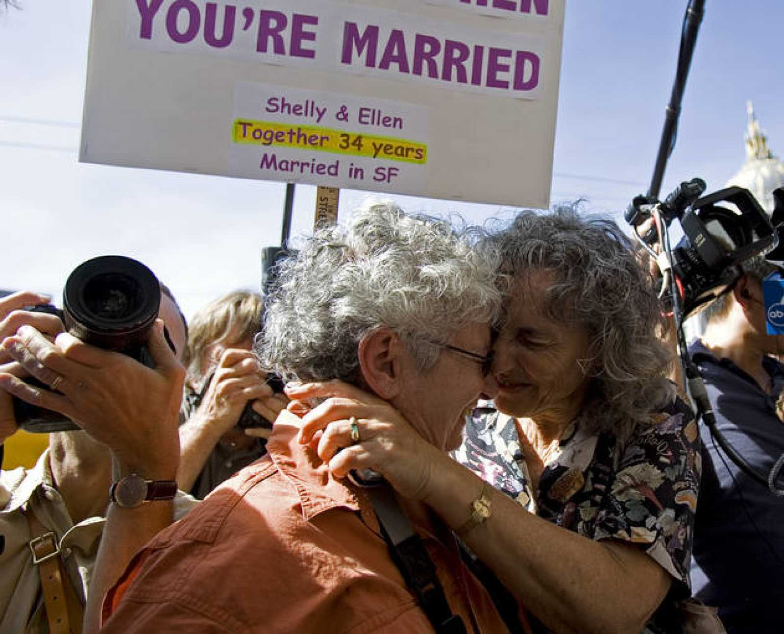 Shelly Bailes and her partner Ellen Pontac hug after hearing a decision by California's Supreme Court in San Francisco