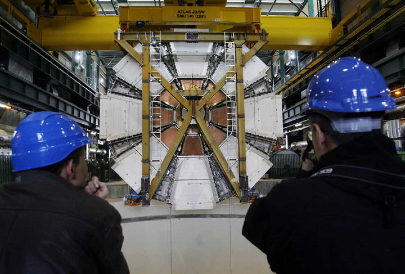 The last element of the ATLAS experiment is lowered into the cave at the CERN in Meyrin near Geneva