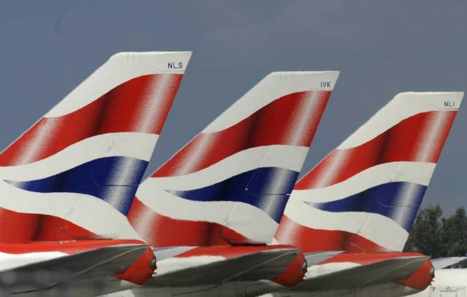 British Airways aircraft tailfins are seen at Heathrow Airport in west London