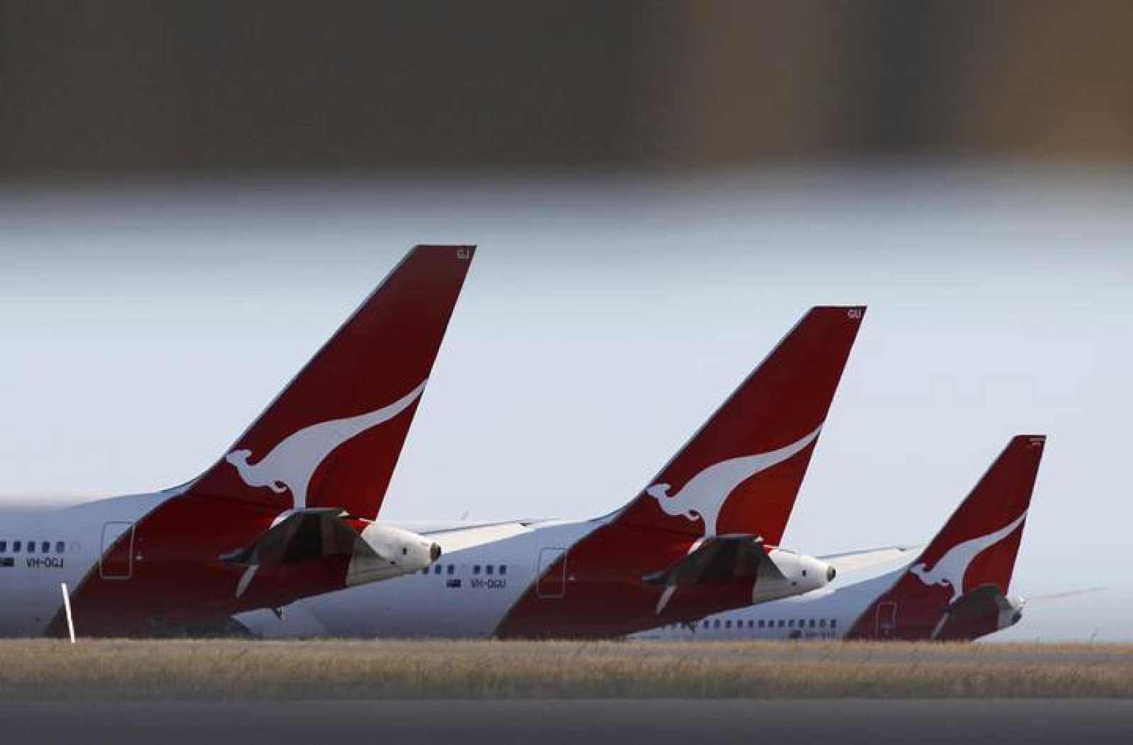 Qantas planes are seen grounded at Perth international airport