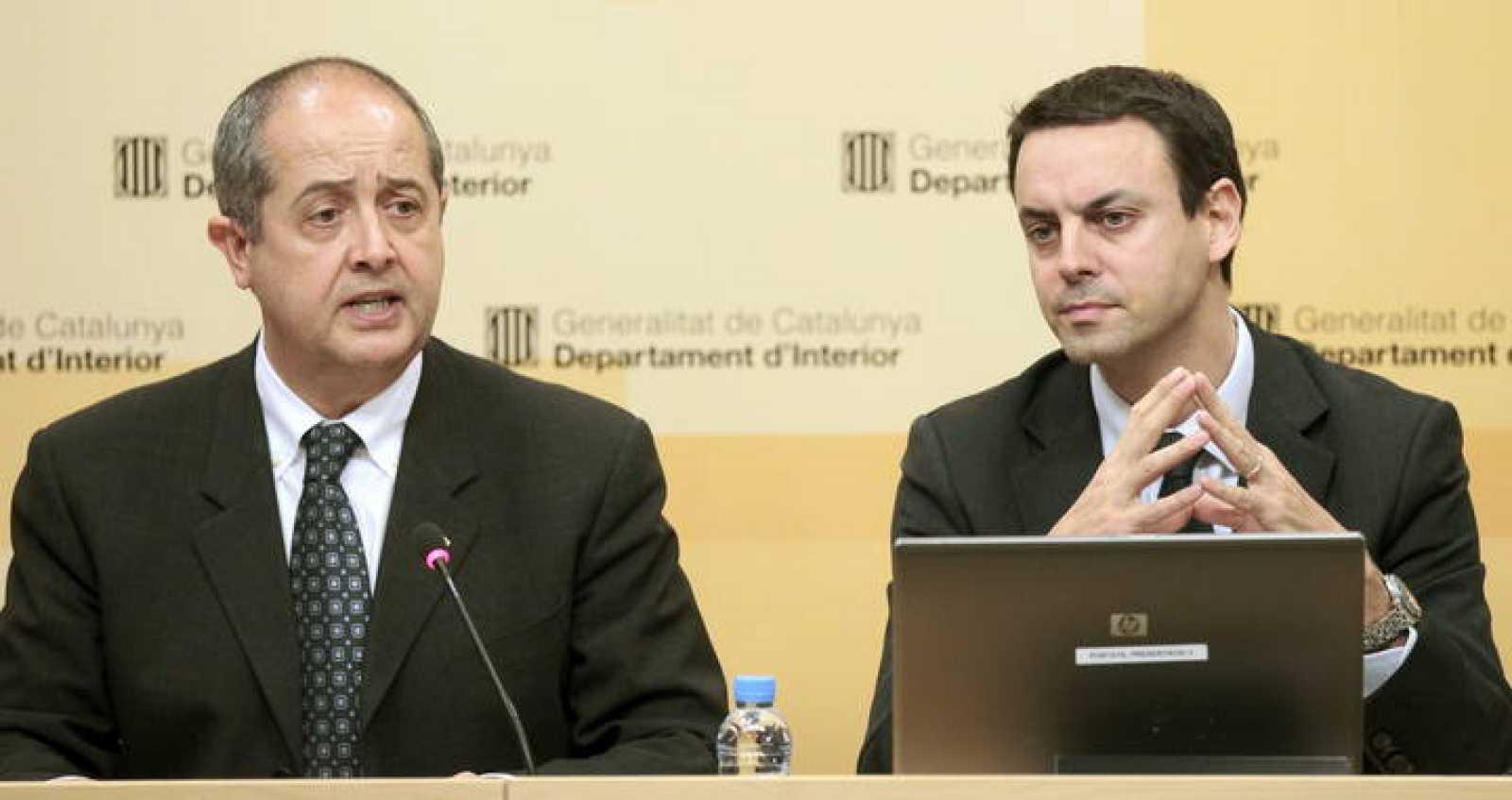 El conseller de Interior, Felip Puig, acompañado del director general de los Mossos d'Esquadra, Manel Prat.