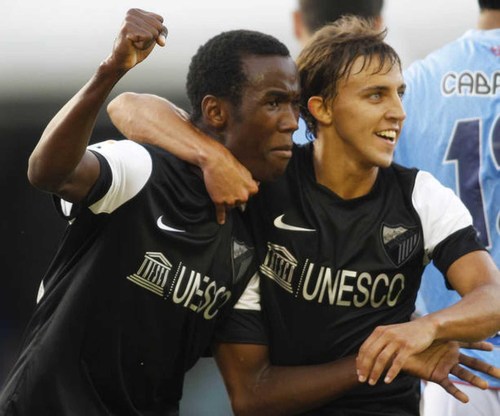 Fabrice celebra con Buonanotte su gol para el Málaga contra el Celta de Vigo