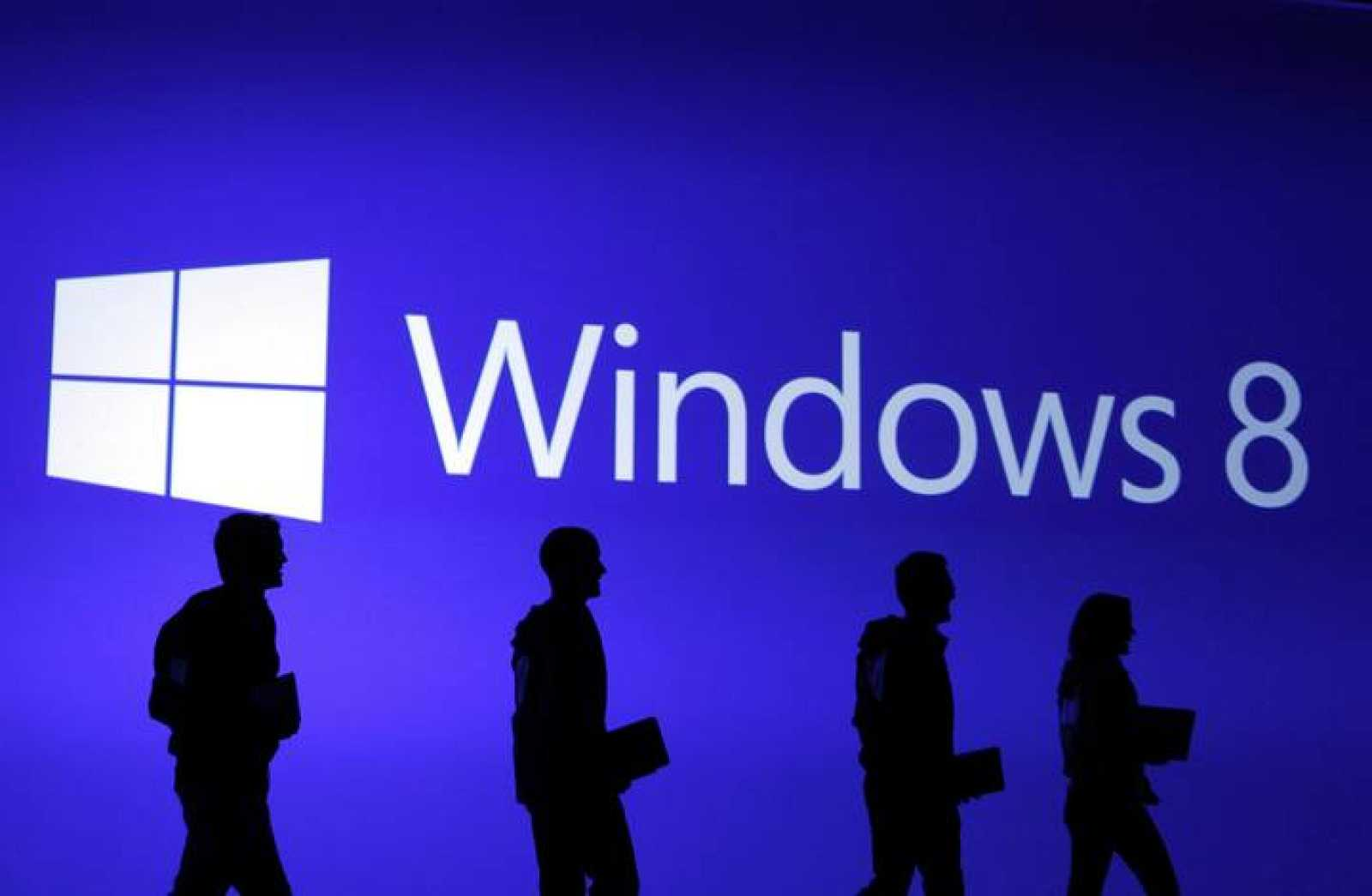 Guests are silhouetted at  the launch event of Windows 8 operating system in New York