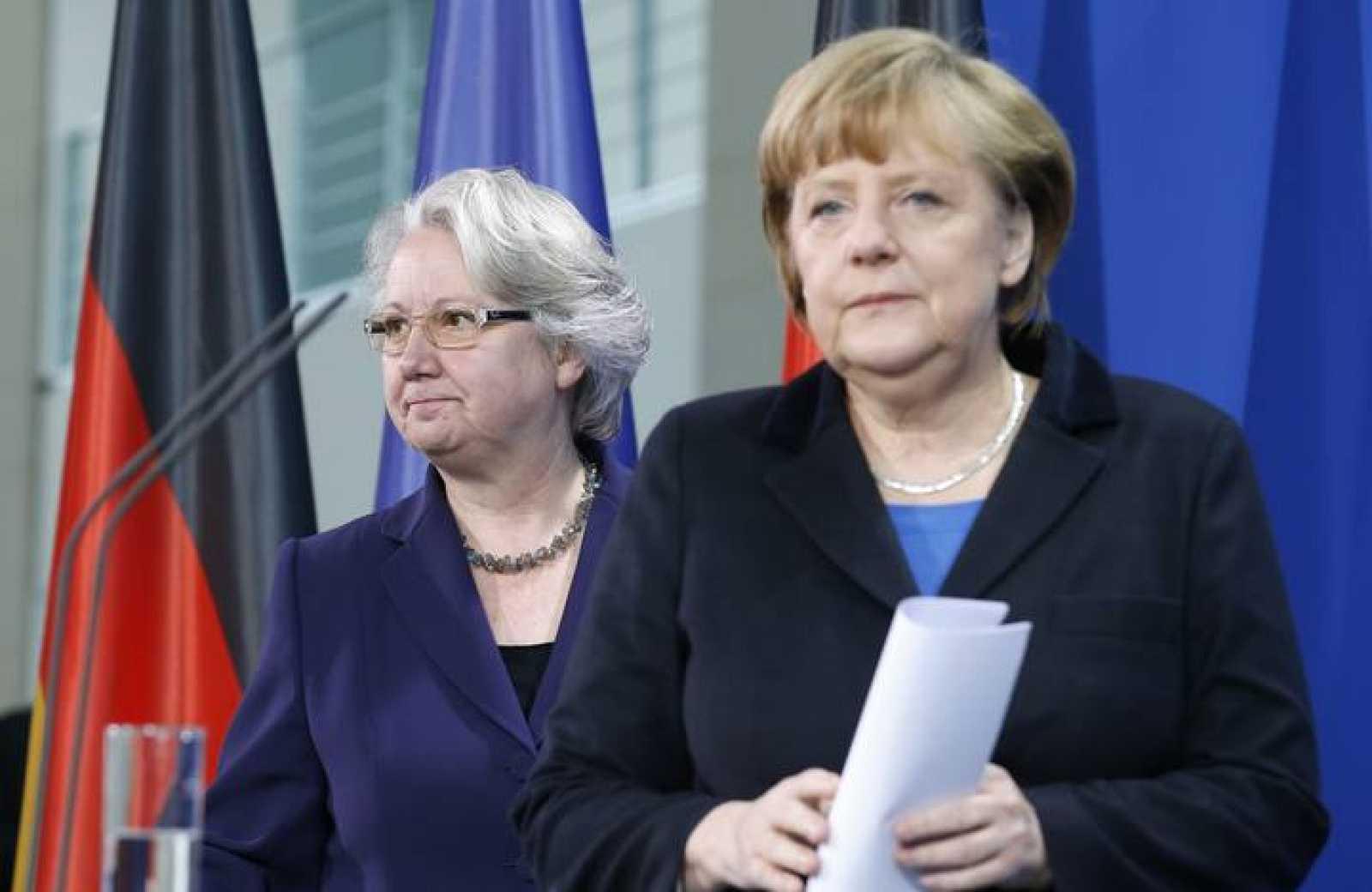 German Chancellor Merkel and Education Minister Schavan arrive for statement to media in Berlin