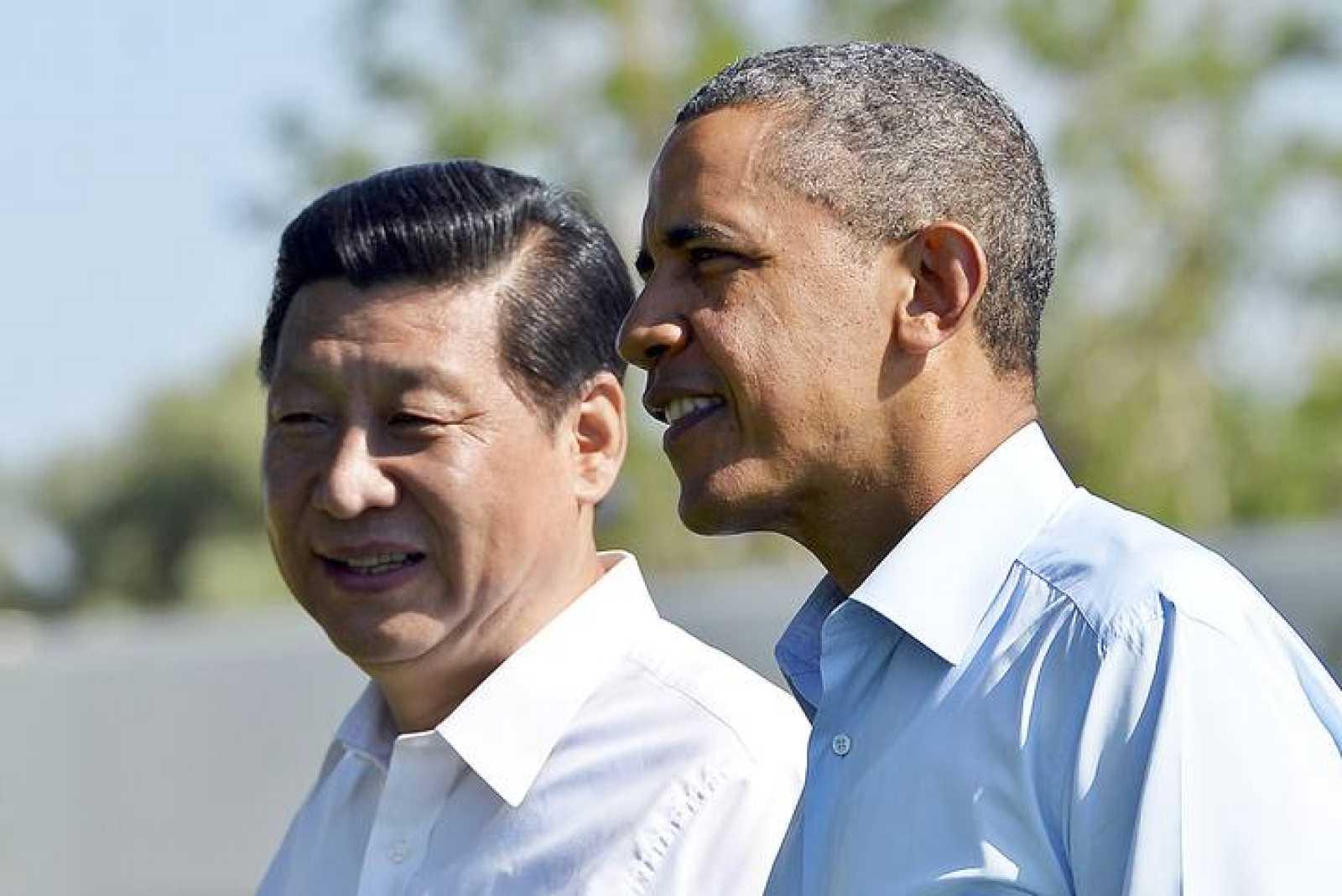 Barack Obama y Xi Jinping pasean juntos durante su encuentro en Rancho Mirage, California