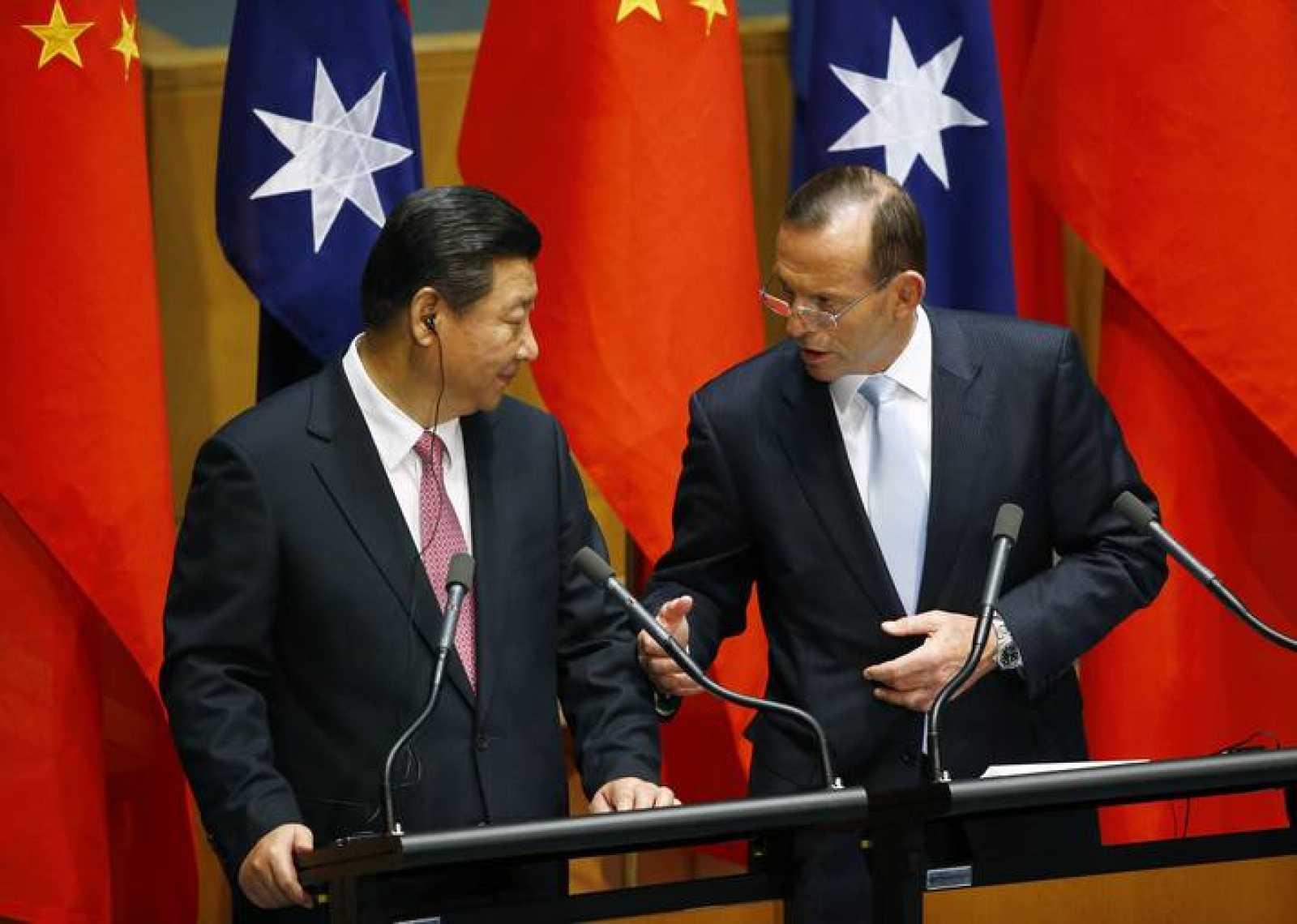 El presidente chino, Xi Jinping, junto al primer ministro australiano, Tony Abbott