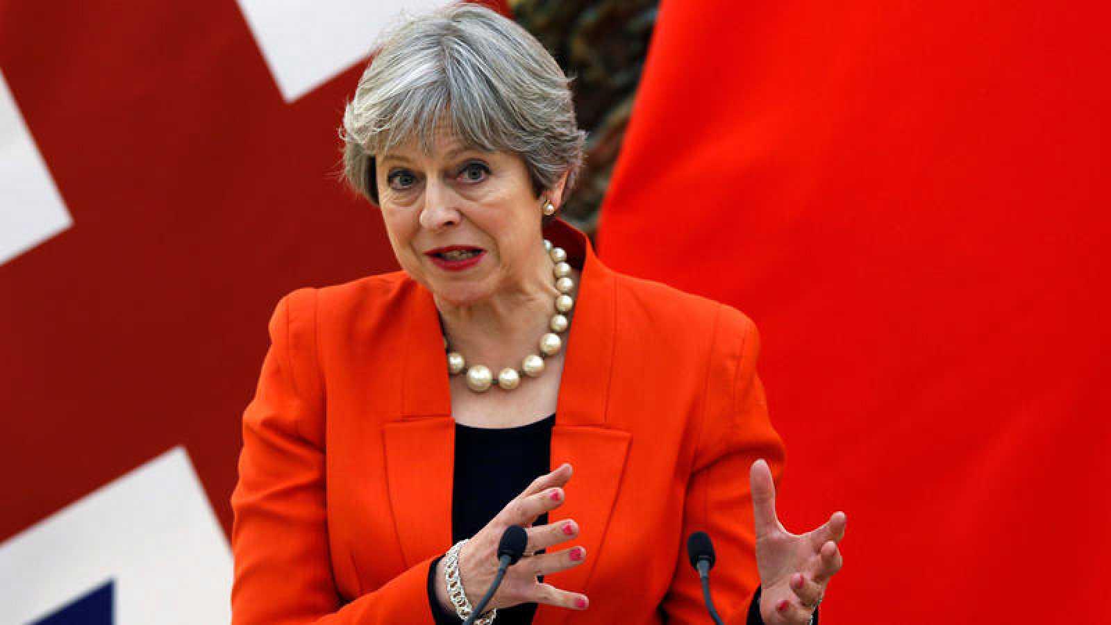 Theresa May, durante una rueda de prensa este miércoles en Pekín