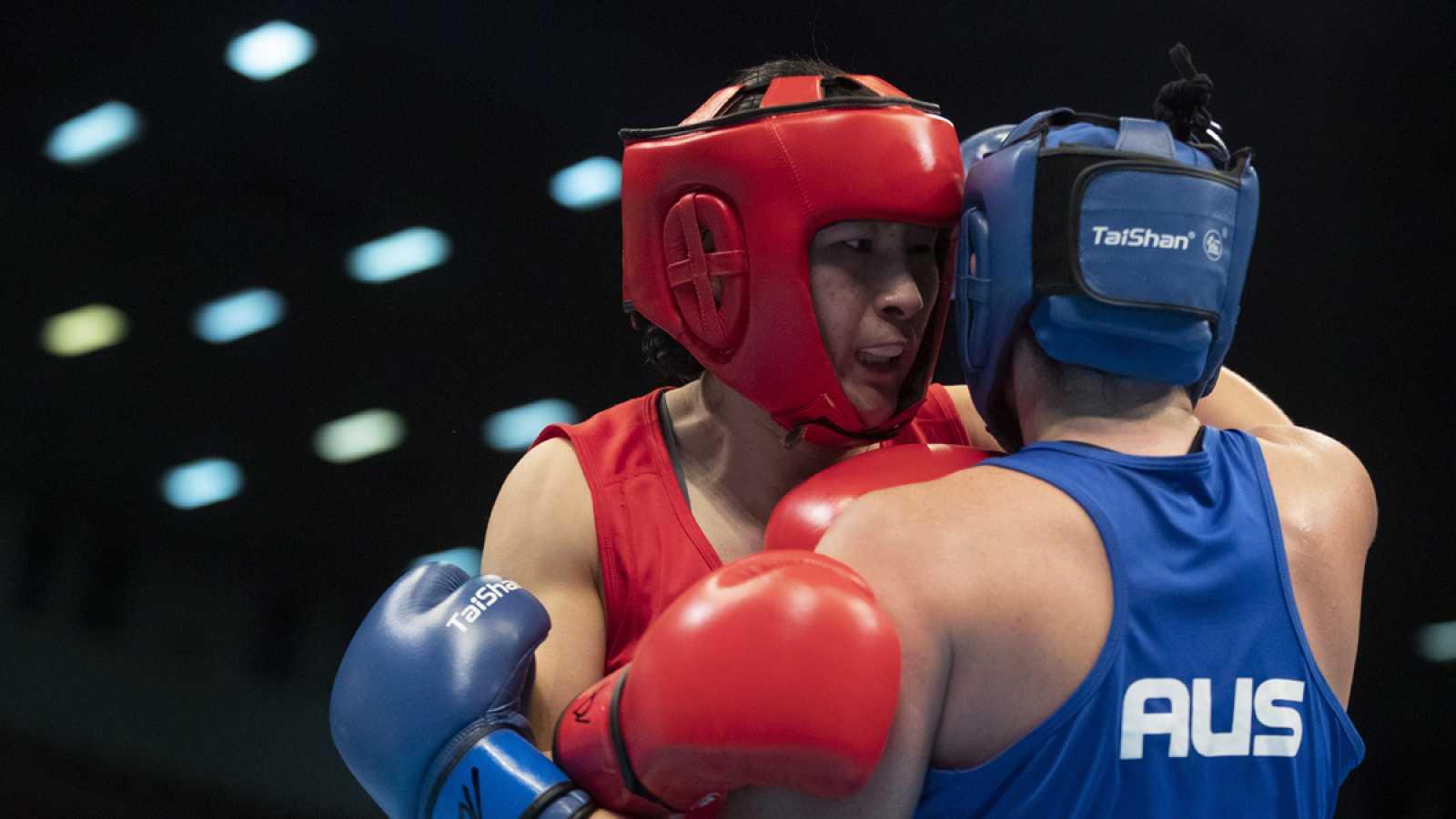 Imagen del combate entre Qian Li y Caitlin Parker