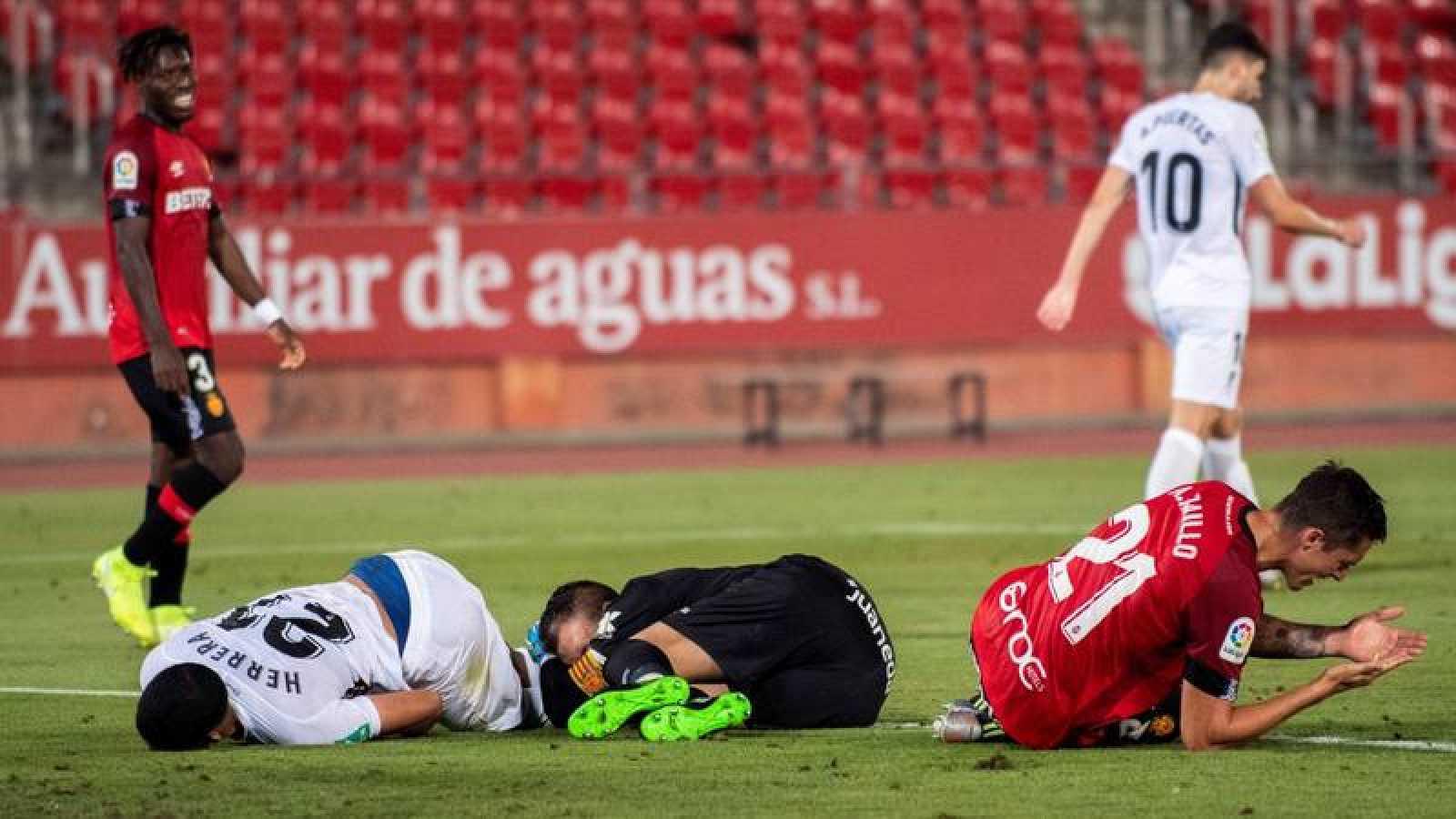 Los jugadores del Mallorca se lamentan.