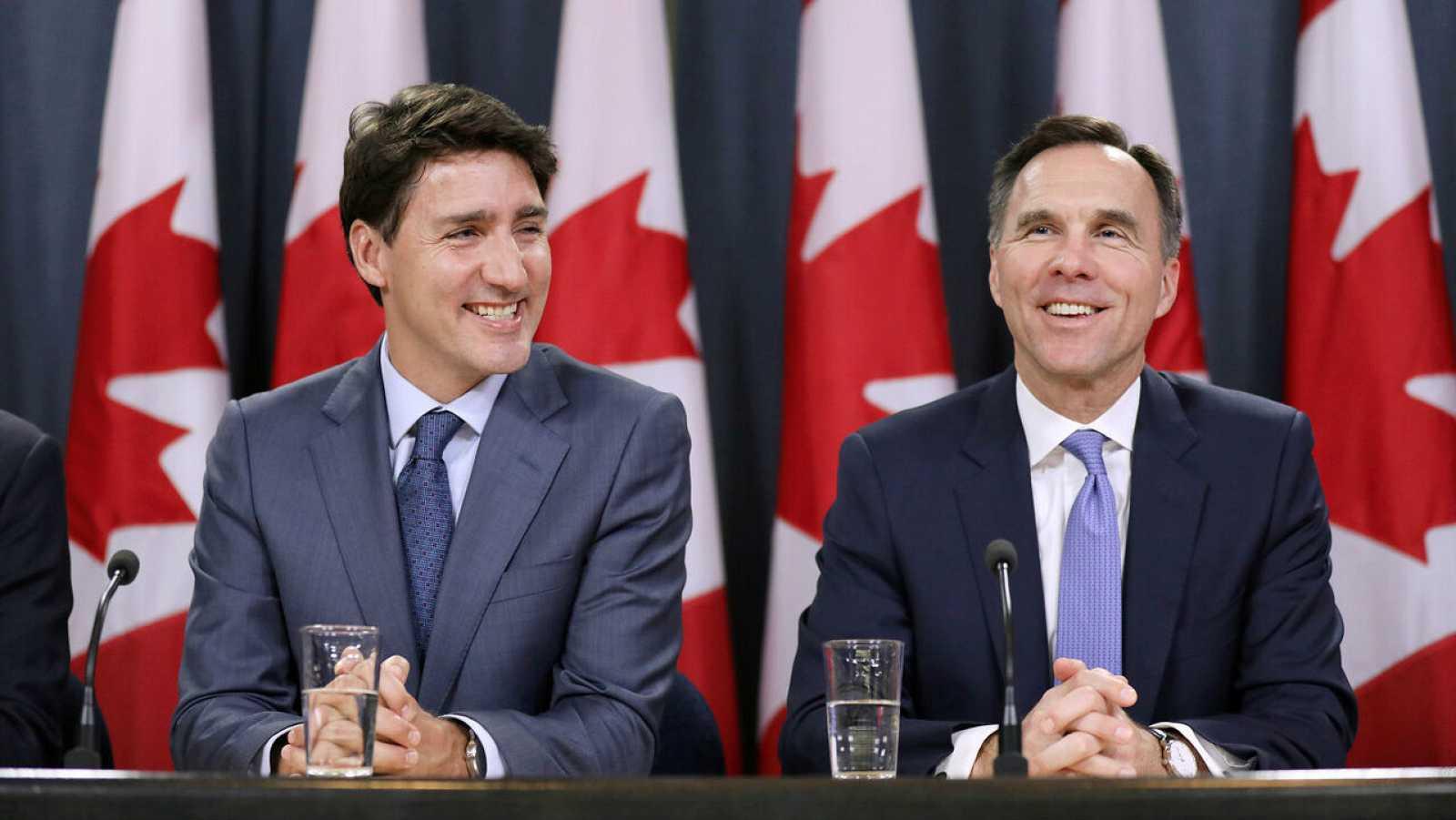 El primer ministro de Canadá, Justin Trudeau, y el ministro de Finanzas, Bill Morneau, durante una conferencia de prensa.