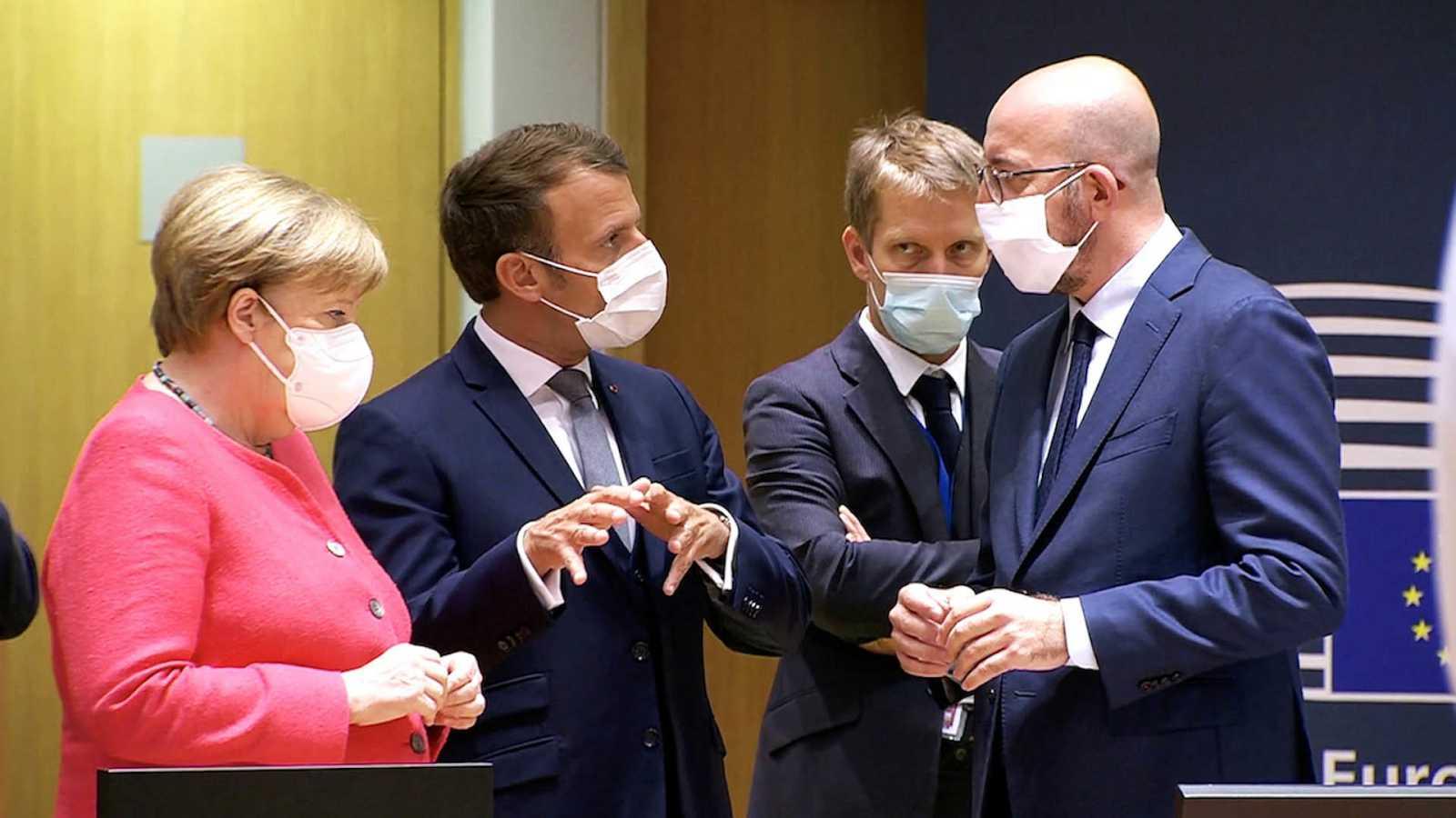 Merkel, Macron, Michel y un asesor