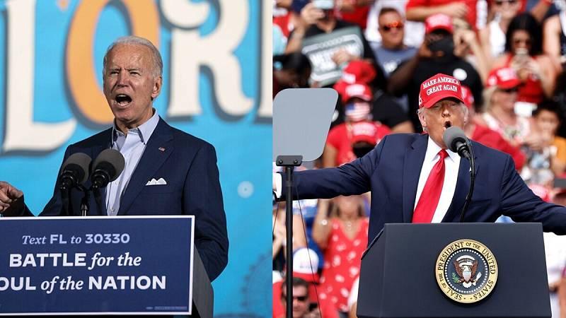 El candidato presidencial demócrata, Joe Biden, (izquierda) habla durante un mitin de campaña en el Florida State Fairgrounds en Tampa, Florida, el 29 de octubre de 2020. Mientras, el presidente de los Estados Unidos, Donald Trump,(derecha) también h