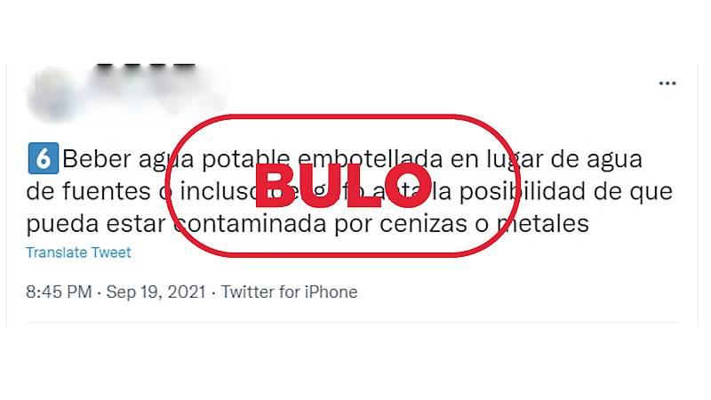 Mensaje de Twitter que recomienda no beber agua de zonas cercanas a la erupción volcánica porque puede estar contaminada, con el sello bulo en rojo de VerificaRTVE