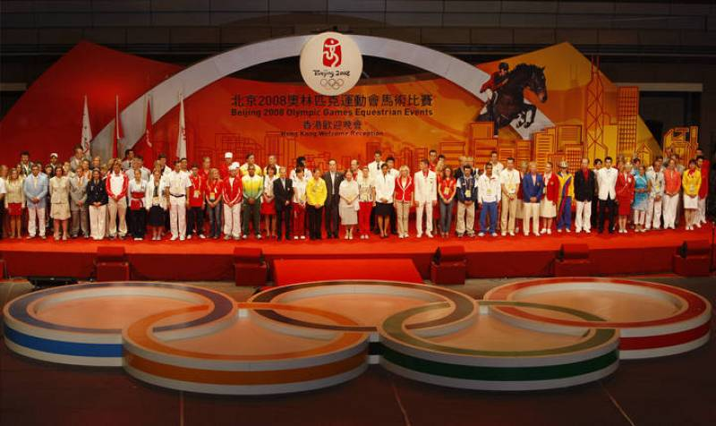 Representatives from countries taking part in the Olympics equestrian event attend an opening ceremony in Hong Kong