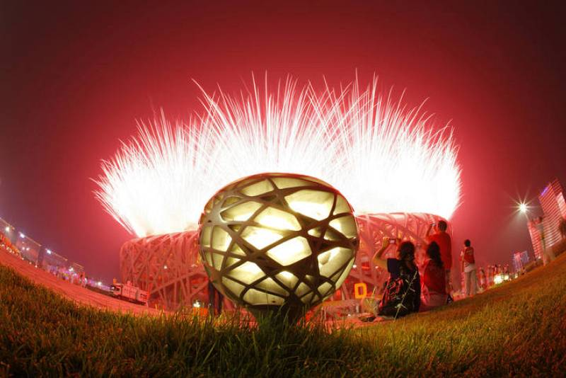 Fireworks explode at the opening ceremony of the Beijing 2008 Olympic Games at the National Stadium