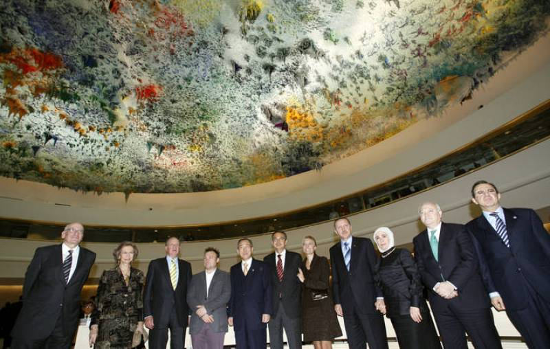 Official pose in the newly renovated Room XX after the unveiling ceremony at the European headquarters of the United Nations in Geneva