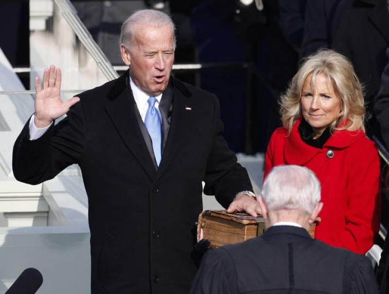 U.S. Vice President Joe Biden takes the oath of office as wife Jill looks on during inauguration ceremony in Washington
