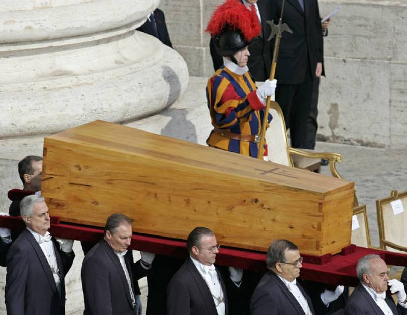 Pallbearers carry the coffin with the remains of the late Pope John Paul II at the start of ...