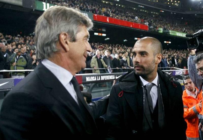 Guardiola conversa con Manuel Pellegrini antes de comenzar el partido