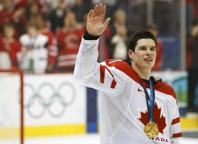 Canada's Crosby waves to the crowd during the medal ceremony after their gold medal hockey game at the Vancouver 2010 Winter Olympics