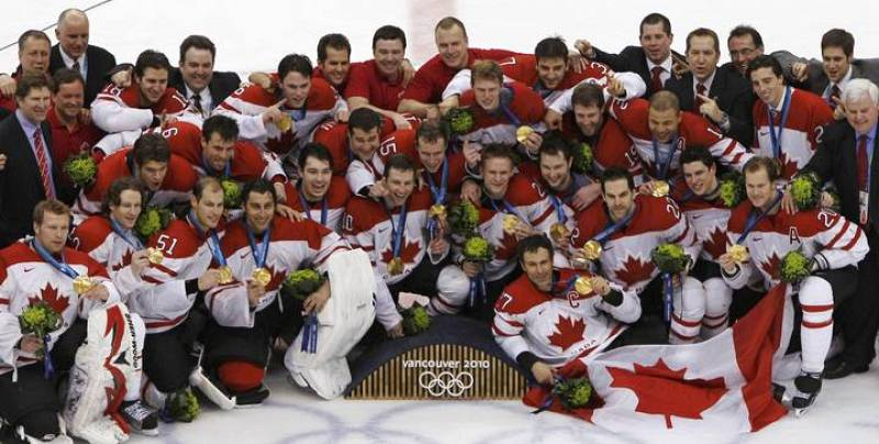 Canada team members pose with their medals after defeating the U.S. in their gold medal hockey game at the Vancouver 2010 Winter Olympics