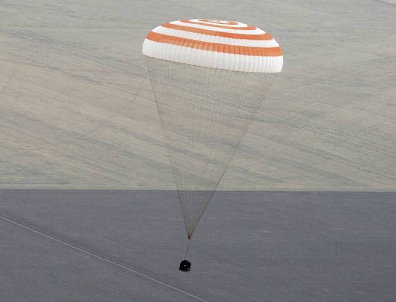 The Soyuz TMA-18 spacecraft is seen as it lands near the town of Arkalyk, northern Kazakhstan