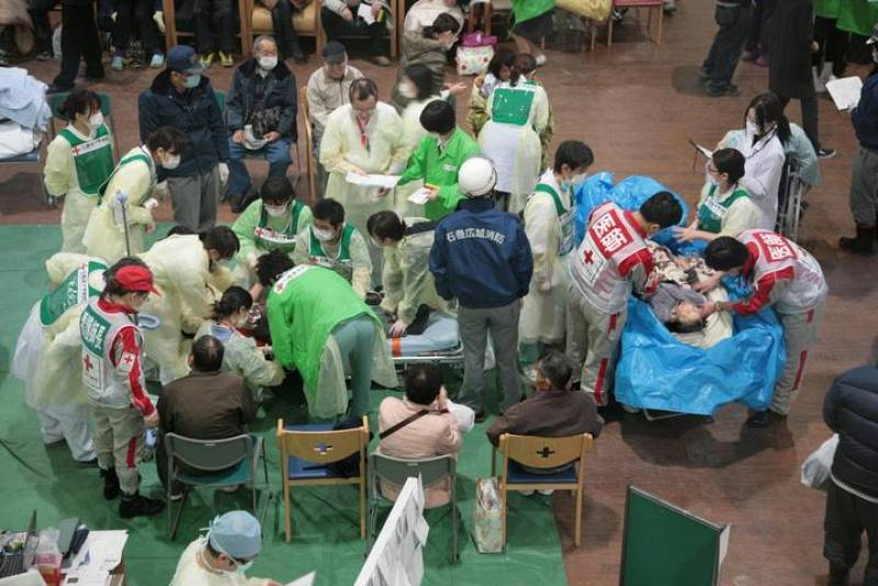 Survivors of an 8.9-magnitude earthquake and tsunami receive treatment at the Ishinomaki Red Cross hospital in Miyagi prefecture