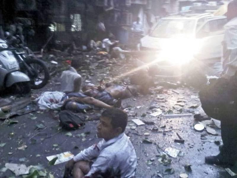 Foto hecha con móvil en la que se ve personas heridas en el suelo