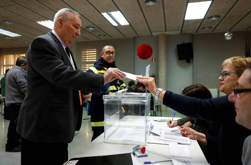 A man votes in Catalonia's regional elections at a polling station in Barcelona