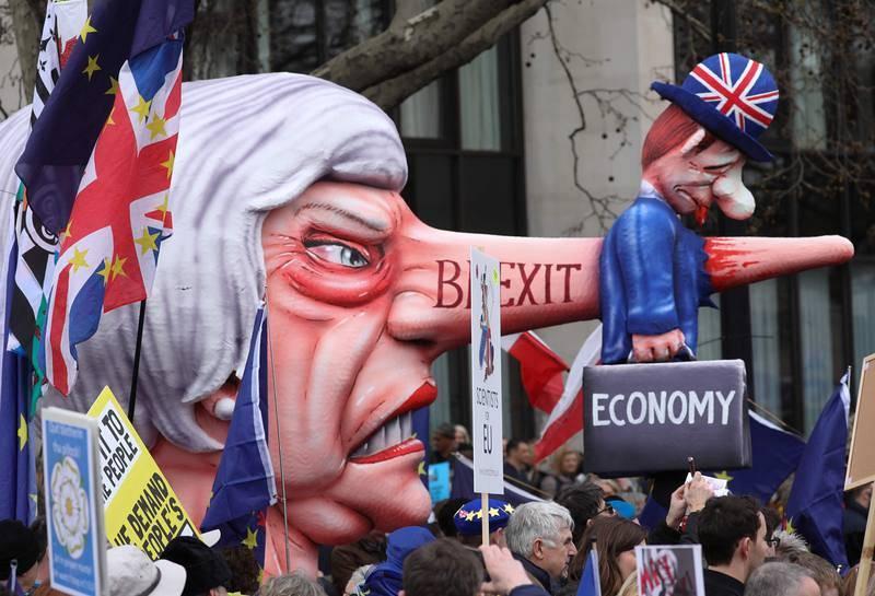 Una marioneta de la primera ministra británica, Theresa May
