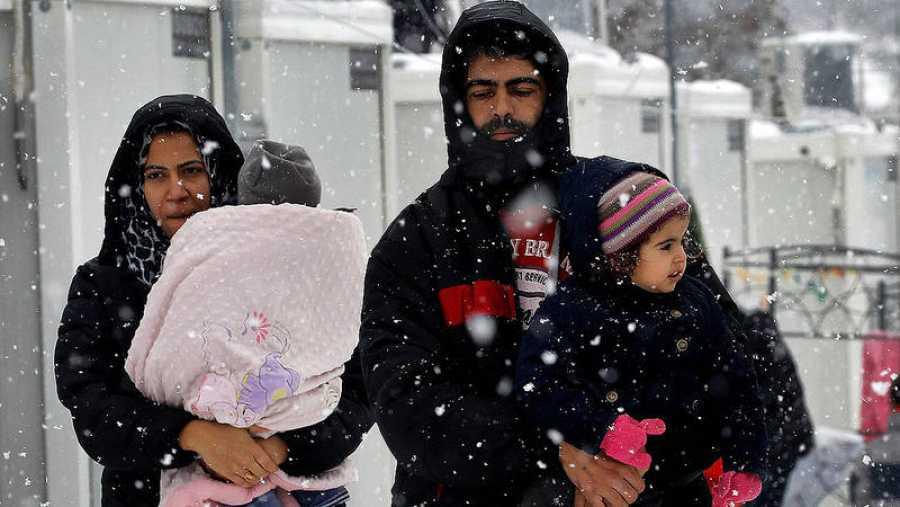 Refugiados sirios en un campo del norte de Atenas, en Grecia