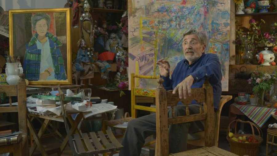 Con su hijo Julián y su pintura
