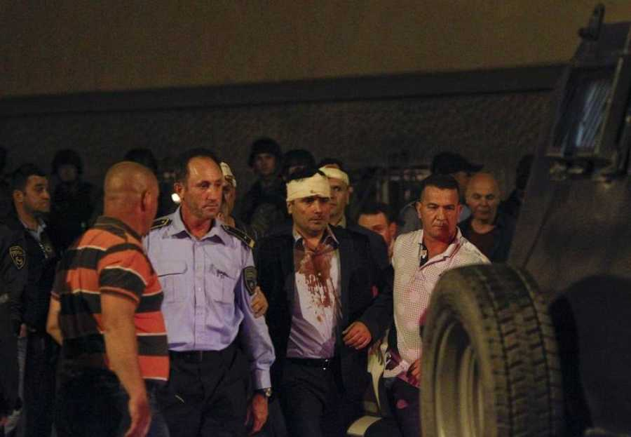 Macedonian police escorts injured members of the parliament including Social Democratic leader Zoran Zaev