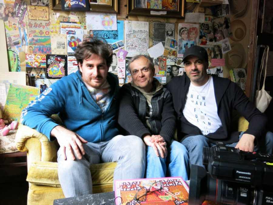 El dibujante Nicolás entre José Guerrero y el locutor Quique Lozano