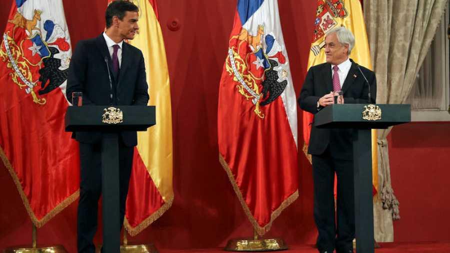 Pedro Sánchez y Sebastián Pinera