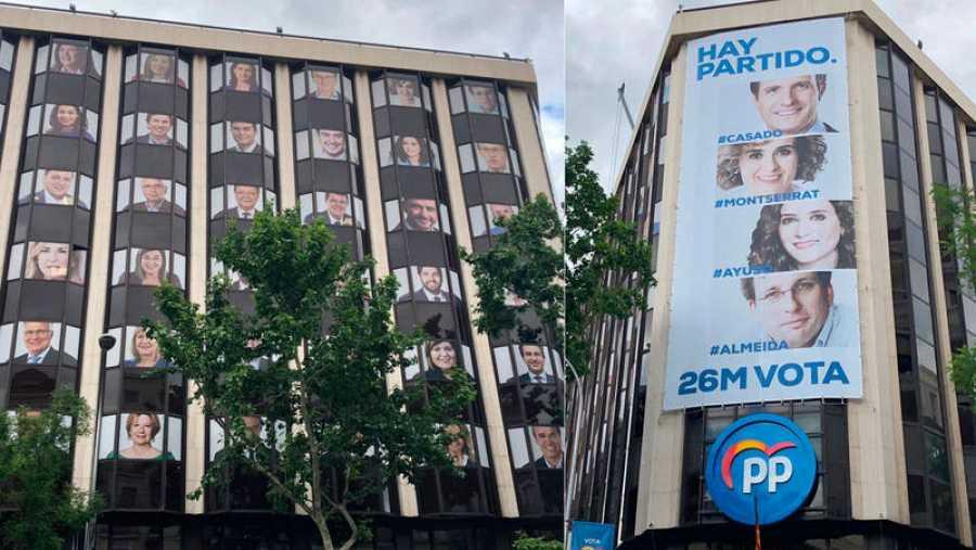 El PP despliega nuevas pancartas en su sede nacional en Madrid para las elecciones del 26M.