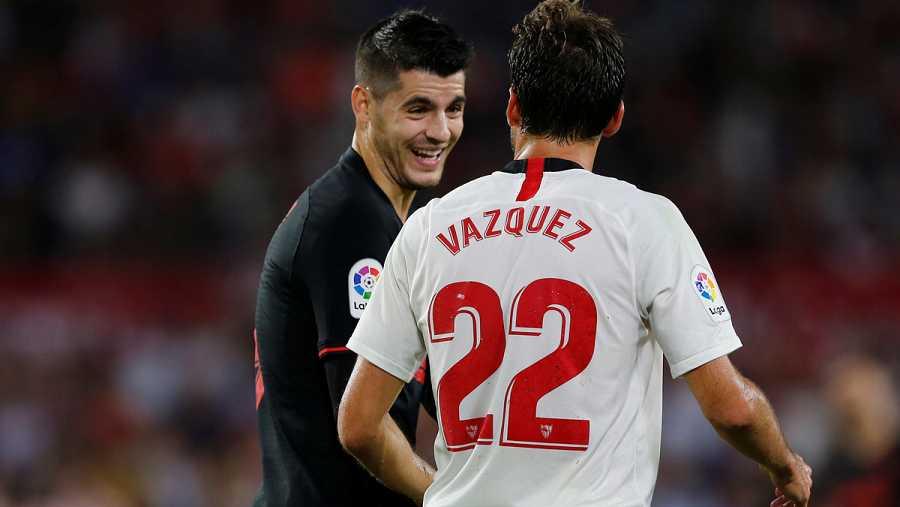 Los autores de los goles, Morata (i) y Vázquez (d)