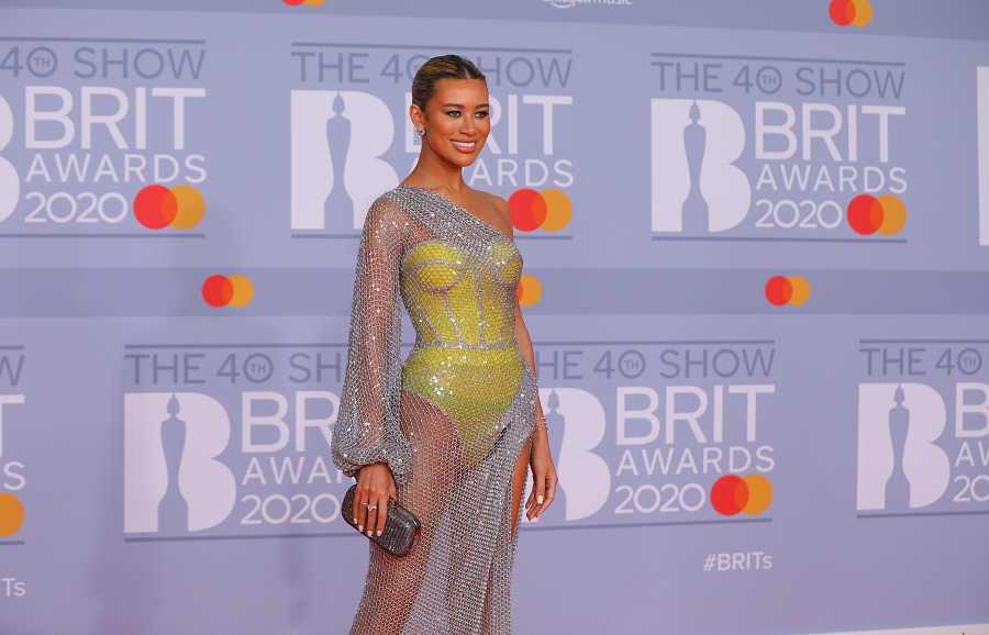 Montana Brown arriesgó con corsé amarillo con una malla superpuesta con efecto vestido asimétrico en los Brit Awards