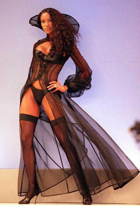 Supermodel Naomi Campbell wears a black satin bra
