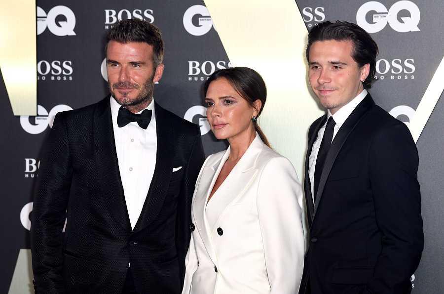 David y Victoria Beckham con su hijo Brooklyn