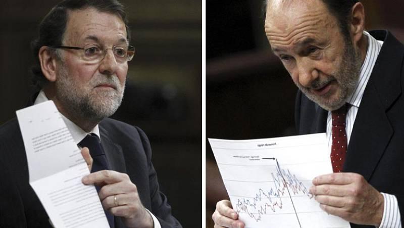 Rajoy y Rubalcaba se enfrentan por el motivo que hay detrás de la bajada de la prima de riesgo española
