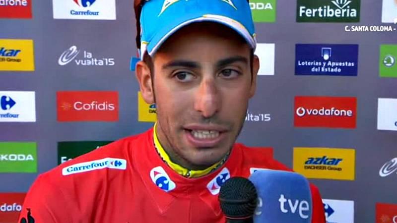 El italiano Fabio Aru (Astana) se ha convertido en el virtual  ganador de La Vuelta a España tras protagonizar una espectacular  remontada, gracias a su equipo, ante el holandés Tom Dumoulin  (Giant), en una vigésima y penúltima etapa, disputada sobr