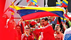 Chavistas y opositores salen a las calles de Caracas por la ayuda humanitaria