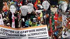 Miles de personas se manifiestan en protesta por la cumbre del G7