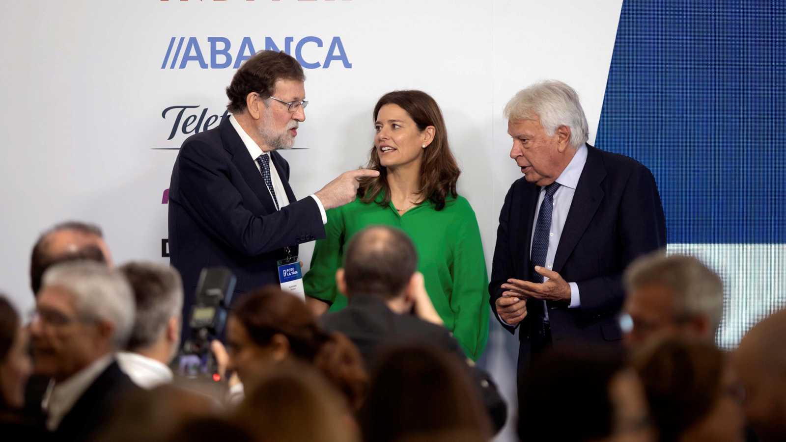 González y Rajoy discrepan ante la gran coalición pero apoyan pactos PSOE-PP