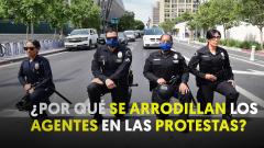 Arrodillarse ante los que protestan, un poderoso gesto cargado de simbolismo