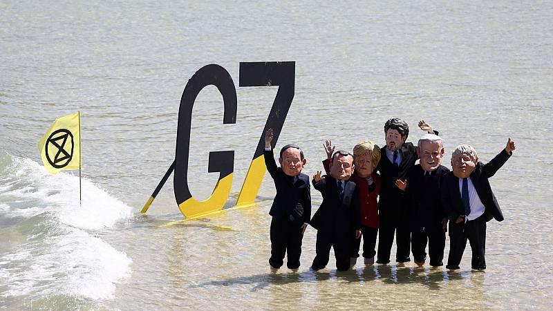 Grupos ecologistas y antiglobalización reivindican la lucha contra el cambio climático y vacunas para todos durante la cumbre del G7